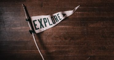 """Stick with banner that says """"Explore"""""""