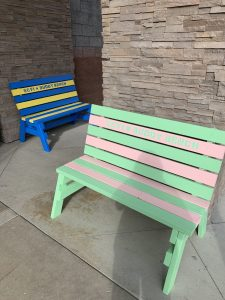 two painted benches with the words SCVi Buddy Bench
