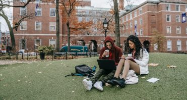 students on lawn of college campus