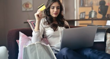 woman on laptop with credit card